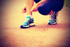 Young fitness woman tying shoelaces Stock Image