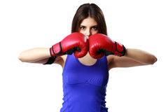 Young fitness woman wearing boxing gloves standing Royalty Free Stock Photography