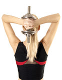 Young fitness womans back and dumbbell Stock Photography