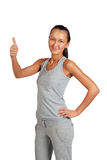 Young fitness women in sport wear. Finger up Royalty Free Stock Photos