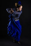 Young flamenco dancer in beautiful dress on black background. Stock Photo