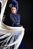 Young flamenco dancer in beautiful dress on black background. Stock Photos