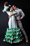 Young flamenco dancers in beautiful dress on black background. Stock Photo
