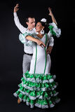 Young flamenco dancers in beautiful dress on black background. Royalty Free Stock Photos