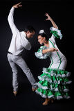 Young flamenco dancers in beautiful dress on black background. Royalty Free Stock Photo