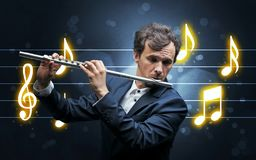 Young flautist with music sheet royalty free stock images