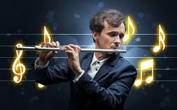 Young flautist with music sheet royalty free stock photography