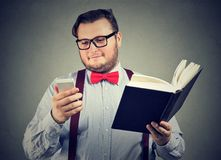 Content student with book and smartphone royalty free stock images