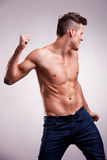 Young flexed muscular dancer Stock Image