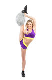 Young flexible cheerleader woman dancer in modern dance pose o Stock Photography