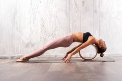 Young fit woman doing purvottanasana yoga pose Royalty Free Stock Photography