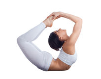 Young flexible woman doing yoga in studio Stock Photo