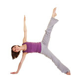 Young flexible woman stretching her Royalty Free Stock Image