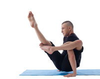 Young flexible yogi posing in complicated asana Royalty Free Stock Photography