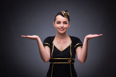 The young flight attendant on gray background Royalty Free Stock Image