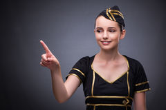 The young flight attendant on gray background Stock Photography