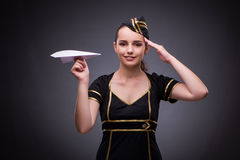 The young flight attendant on gray background Stock Images
