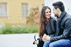 Young flirting couple in love outdoor Stock Photos