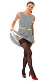Young Flirting Woman Lifting Skirt Flashing Stocking Tops Stock Photography