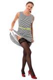 Young Flirting Woman Lifting Skirt Flashing Stocking Tops Stock Photography