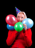 Young flirty happy girl with balloons. Portrait of attractive playful  blonde with balloons Royalty Free Stock Images