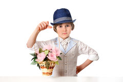 A young florist in the hat with basket of flowers Royalty Free Stock Photo