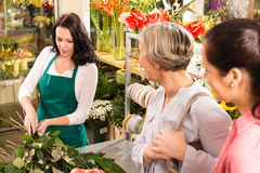Young florist preparing cut flowers shop buyers Stock Photo