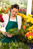Young florist preparing flowers bouquet shop store Stock Photography
