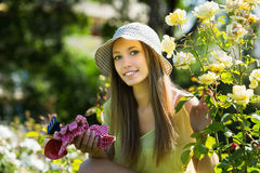 Young florist  in yard gardening Royalty Free Stock Image