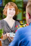 Young Flower Shop  Customer using Electronic Coupon Royalty Free Stock Photo