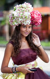 Young flower women with mobile phone Royalty Free Stock Photo