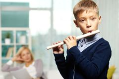 Young flute player Royalty Free Stock Images