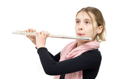Young Flute Player Performing Indoors Against White Background Royalty Free Stock Image