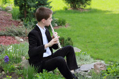Young flutist  Stock Image