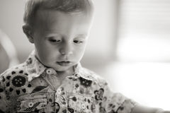 Very focused young child Royalty Free Stock Photo