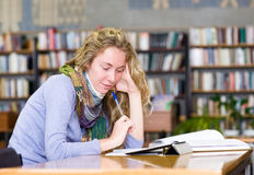 Young focused student using a tablet computer in a library Stock Photo