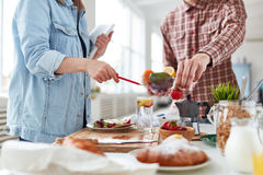 Commercial Photoshoot of Appetizing Breakfast. Young food-photographer and food-stylist getting ready for commercial photoshoot of appetizing breakfast with royalty free stock image