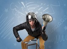 Crazy rider on the bike. Young foolish crazy rider with doodle on the background Royalty Free Stock Image