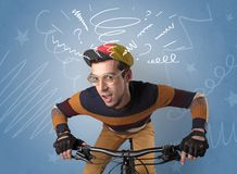 Crazy rider on the bike. Young foolish crazy rider with doodle on the background royalty free stock images