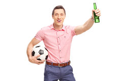 Young football fan holding a bottle of beer Royalty Free Stock Image