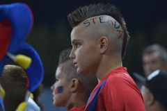 Young football fan with punk haircut. Pictured during the match between Steaua Bucharest and CFR Cluj. Steaua won the game, 3-0 Stock Image