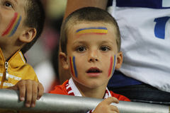 Young football fan. Young romanian football fan pictured during Romania - Hungary FIFA World Cup qualifier football game at National Arena, Bucharest. Romania Stock Photo