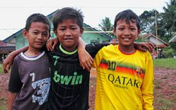 Young football fans. Young Indonesian football fans in tricots. Java, Indonesia royalty free stock image