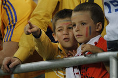 Young football fans. Young romanian football fans pictured during Romania - Hungary FIFA World Cup qualifier football game at National Arena, Bucharest. Romania Royalty Free Stock Photography