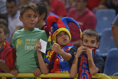 Young football fans. Three young Romanian football fans cheering for their team during the match between Steaua Bucharest and CFR Cluj. Steaua won the game, 3-0 Royalty Free Stock Images