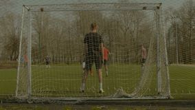 Striker scoring a goal during training match stock video