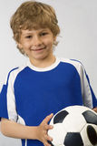 The young football player. With  ball in hands Stock Photos