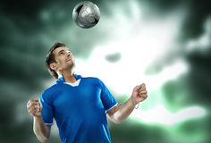 Young football player with ball on isolated backgr Royalty Free Stock Images