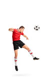 Young football player heading a ball Royalty Free Stock Photography