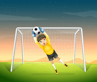 A young football player in his yellow uniform Royalty Free Stock Photos